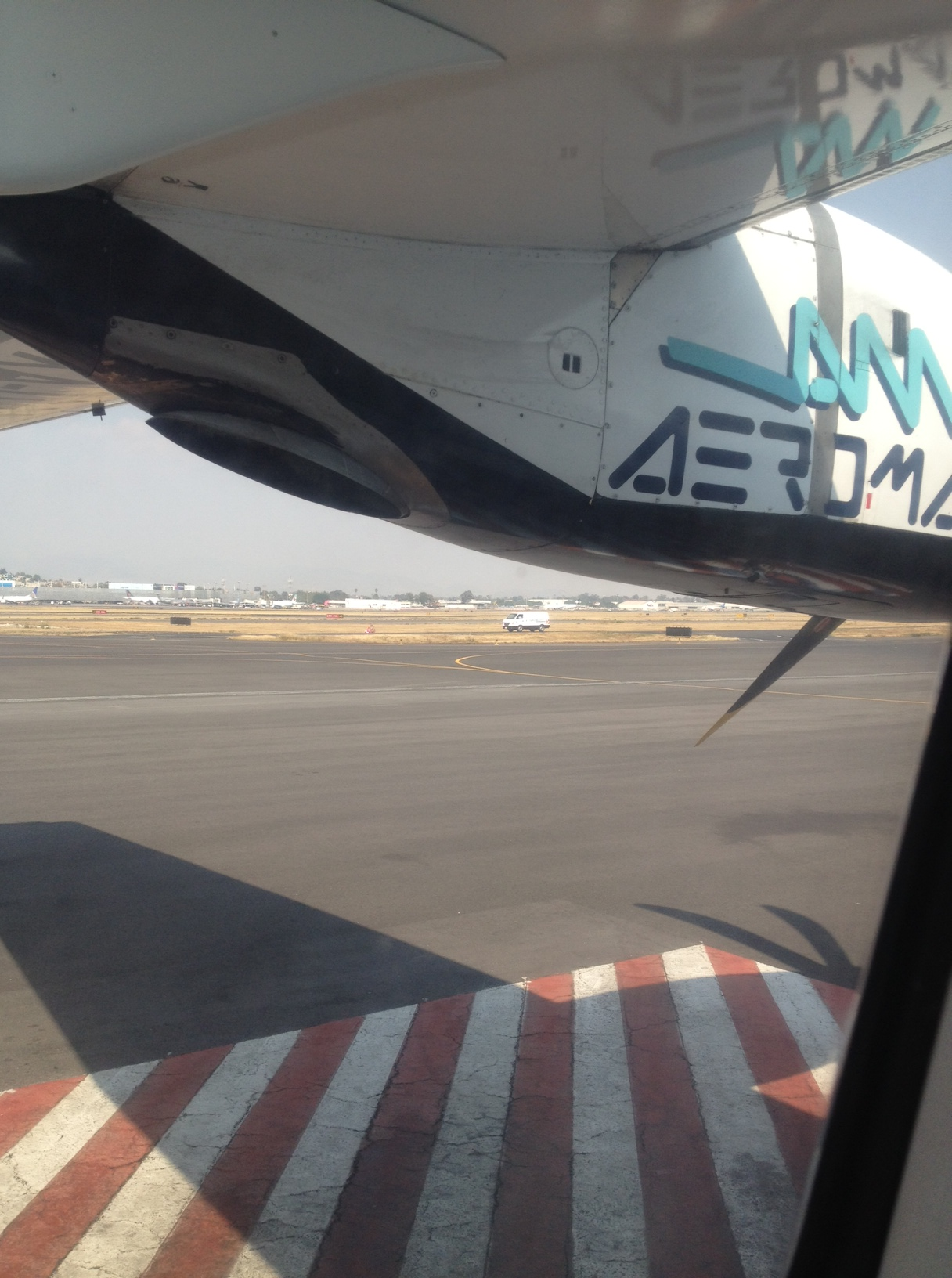 Why yes, that is a turboprop with the Mexico City Airport in the background